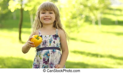 Girl with a vegetable in the hands