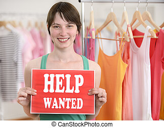 Happy owner of store with help wanted sign - Happy proud...