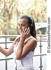 Happy girl talking over the phone . - Attractive girl is...