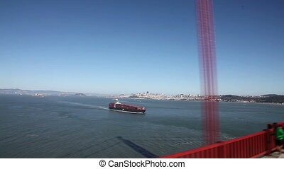 Driving on golden gate bridge looking at the bay and city of...
