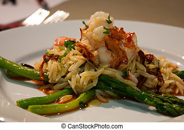lobster risotto closeup - close up of a colorful plate of...