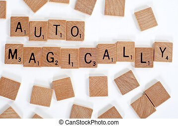 Scrabble tiles spelling out 'Automagically' - Wood Scrabble...