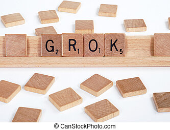 Scrabble tiles spell out Grok - Wood Scrabble tiles spelling...