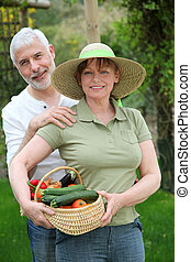 Senior couple standing in kitchen garden