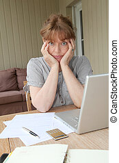 Senior woman having trouble with tax declaration