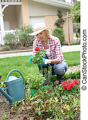 Woman planting flowers in garden