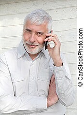 Portrait of senior man talking on the phone