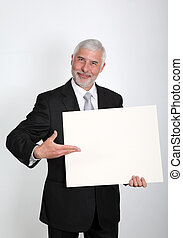 Businessman holding message board
