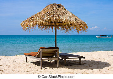Sun loungers with an umbrella on the beach