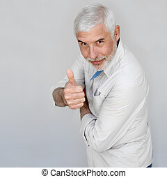 Senior man with thumbs up