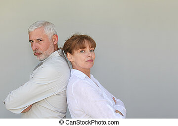 Portrait of senior couple upset at each other