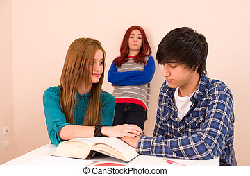 Jealous - Students in classroom, jealous girl looking at a...