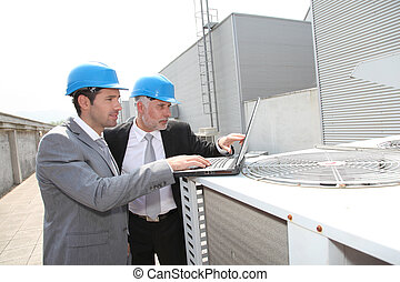 Businessmen on industrial site