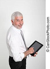 Businessman using electronic tablet