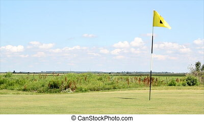 yellow flag number two - golf field with yellow flag number...