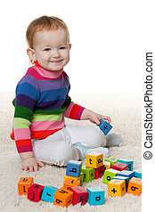 Redhead little girl with blocks