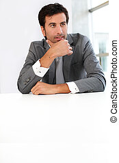 Businessman sitting a his desk for meeting