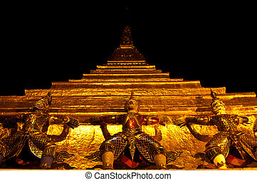 Guardian statue at Wat Phra Kaew in thailand ( at night )