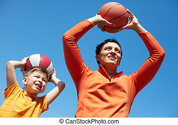 Trainer - Father and son spending time together playing...
