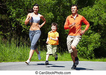 Jogging outdoors - Lovely family jogging in the open air
