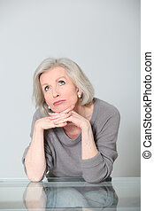 Portrait of senior woman looking pensively