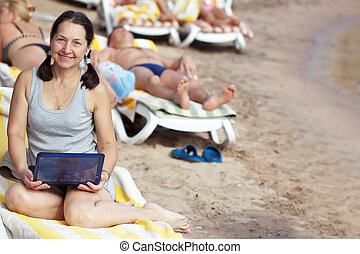 mature woman  with laptop at resort