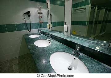 toilet with few sinks - Interior of toilet with few sinks