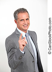 Businessman standing with finger pointed at camera