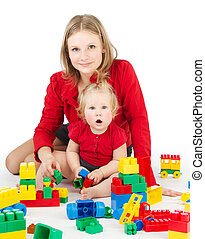 Mother and daughter playing together blocks over white
