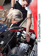 Professional auto mechanic and a client. - Professional auto...