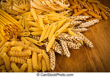 Mix group of italian pasta on the wood table