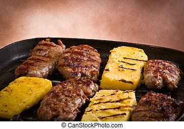 Sausage and sliced of polenta cooked grill