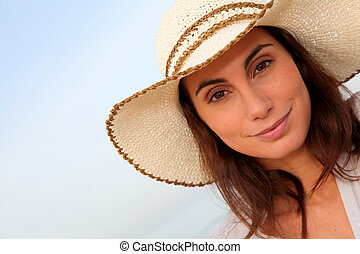 Portrait of beautiful young woman wearing hat