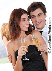 Couple celebrating new years eve with champagne
