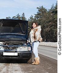 Woman   near  her broken car