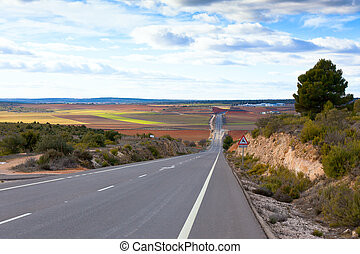 Empty rural road in Central Spain - Empty rural road in...