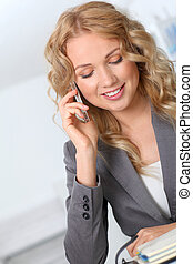 Portrait of businesswoman using mobile phone