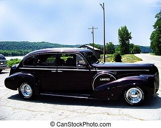 1940 Buick Limited - A 1940 Buick Limited is parked in a...