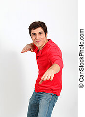 Man in red shirt standing on white background