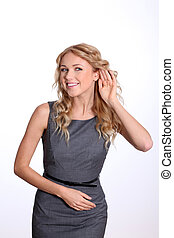 Businesswoman with hand on ear to listen