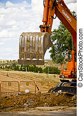 Closeup skid steer loader excavator at road construction...