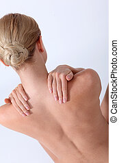 Back view of woman having backache