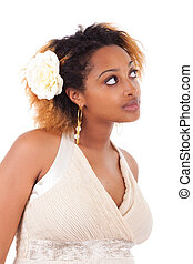 Young beautiful african american woman looking up