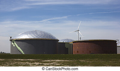 oil tanks with blue sky