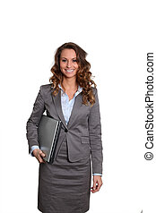 Businesswoman standing on white background with laptop computer