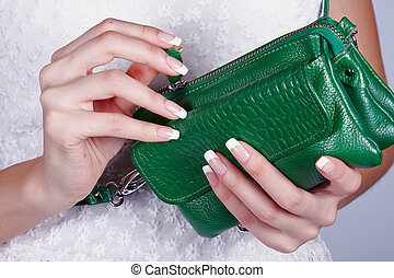 Female hands with manicure with handbag - Beautiful female...
