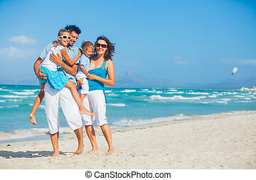 Family having fun on tropical beach - Family of four having...