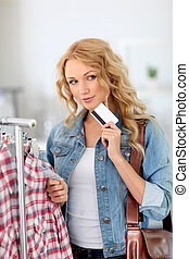 Attractive woman in clothing store