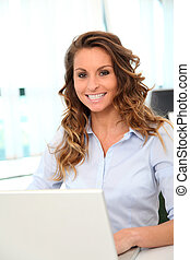Portrait of smiling businesswoman in the office