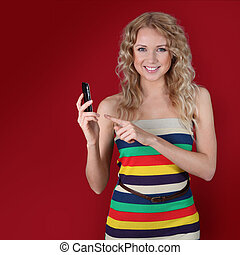 Beautiful woman pointing at mobilephone